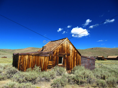 Old house and blue sky in Bodie.