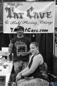 Kidd Joe of the Tat Cave holding his plaque for 1st place