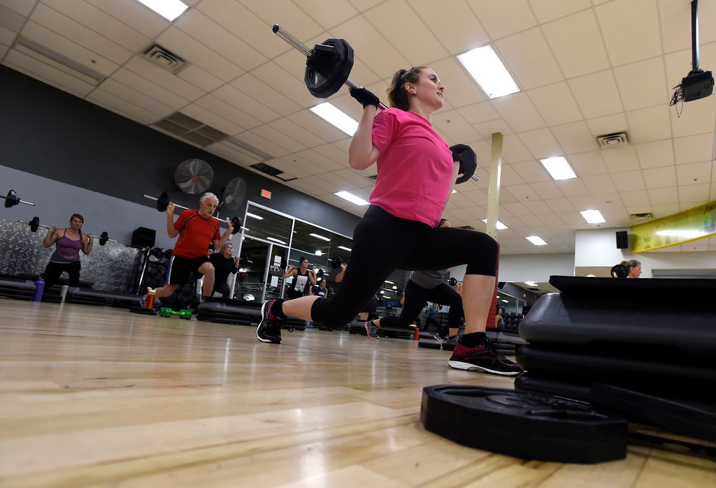 . BOULDER, CO - OCTOBER 10, 2018: Aly Krimmer works out during a Body Pump workout on Wednesday at 24 Hour Fitness in Boulder. For more photos of the class go to dailycamera.com (Photo by Jeremy Papasso/Staff Photographer)