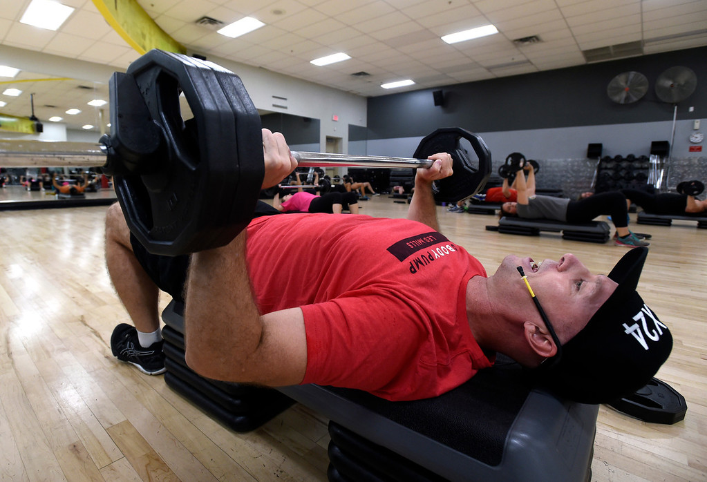 . BOULDER, CO - OCTOBER 10, 2018: Instructor Steve Carroll leads his Body Pump workout class on Wednesday at 24 Hour Fitness in Boulder. For more photos of the class go to dailycamera.com (Photo by Jeremy Papasso/Staff Photographer)