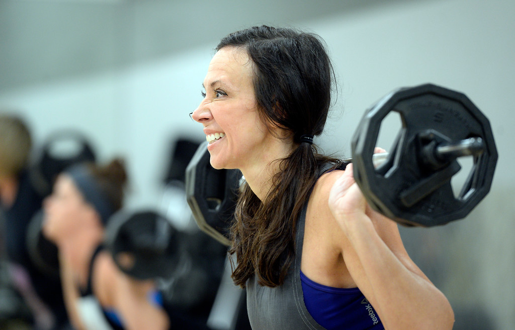 . BOULDER, CO - OCTOBER 10, 2018: D\'Nelle Carnahan works out during a Body Pump workout on Wednesday at 24 Hour Fitness in Boulder. For more photos of the class go to dailycamera.com (Photo by Jeremy Papasso/Staff Photographer)