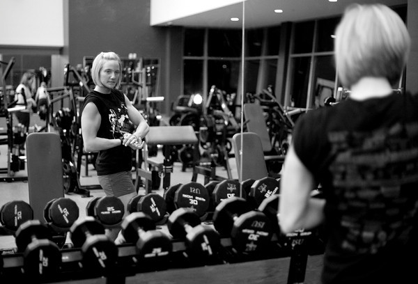 Kaylee flexes in the gym at Indiana State University where she attends classes. With her busy schedule of classes, work, and ROTC training, she can only fit in her workouts early in the morning.