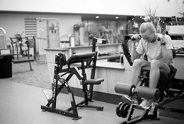Kaylee works out on a machine as she prepares for her upcoming competition.