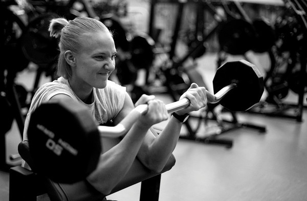 Kaylee Terwoord lifts weights in the gym at Indiana State University where she attends classes. Terwoord is preparing for her second appearance at the annual Indiana State University and Wabash Valley Bodybuilding and Fitness Contest at the university.