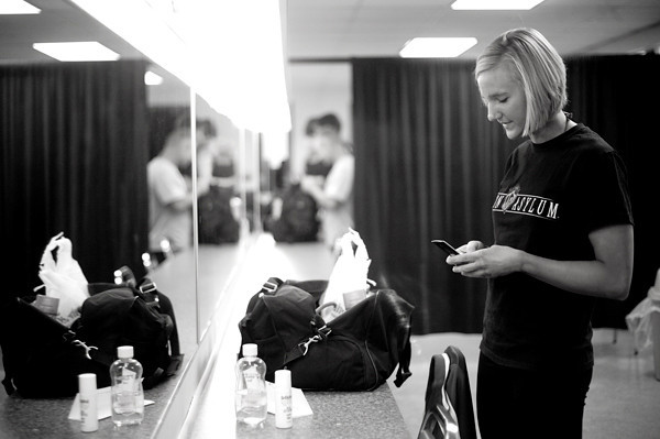 Kaylee checks her phone as she arrives back stage to get ready for the annual Indiana State University and Wabash Valley Bodybuilding and Fitness Contest at Indiana State University on March 27, 2010.