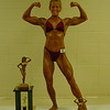 Cathy posing with trophies 10-16-04