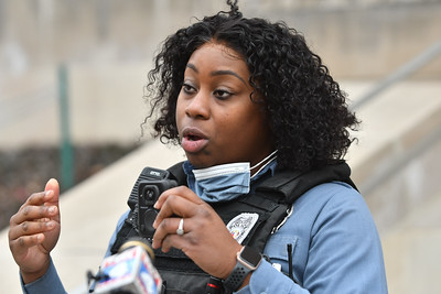 Kansas City Police Officer Oasha White demonstrates how police detach and use the bodycams that are being added to the KCPD officers' equipment. Jan. 13, 2021 photo.