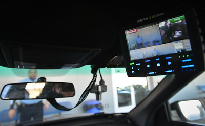 View of monitor that displays dash cam video inside KCK police unit.