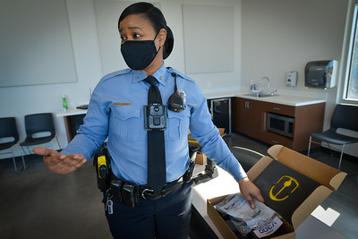 Body-worn cameras in Kansas City Kansas, Feb. 2021, are demonstrated by KCK police.