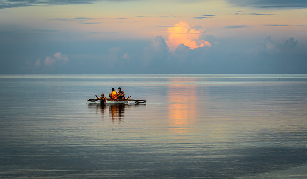 Fishermen prepare to cast their net at Bohol in the Philippines