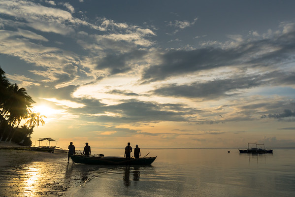 Local fishermen prepare to head out for the morning catch at Anda on the island of Bohol in the Philippines