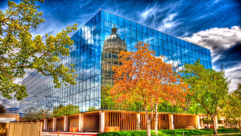 Capitol refection off glass office building
