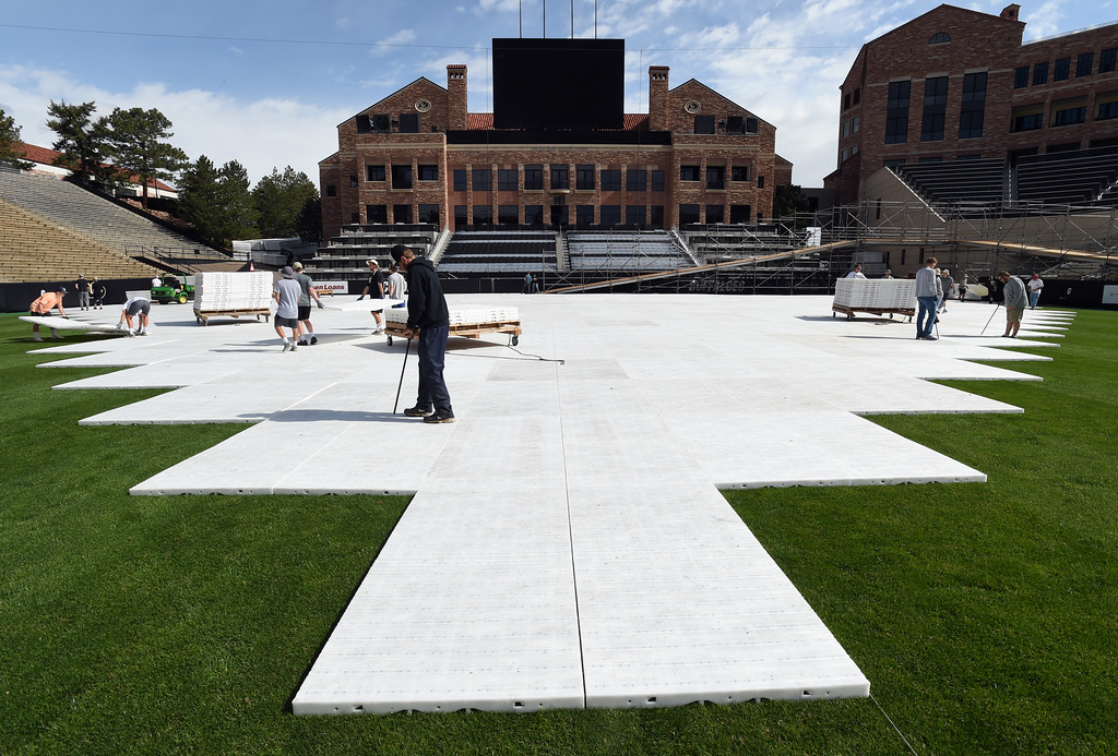 . Plastic tiles are placed over the Folsom turf for the finish line area of Monday\'s Bolder Boulder 10K race. Members of the University of Colorado men\'s club lacrosse team  among others, put down the Folsom Field floor and volunteers packed lunches 55,000 in Balch Field House on Saturday. For more photos and a video, go to www.dailycamera.com.  Cliff Grassmick  Staff Photographer May 27, 2017