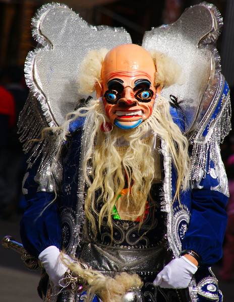 "A performer from the Fiesta del Gran Poder wearing a monster-like costume - La Paz, Bolivia.  Travel photo from the Fiesta del Gran Poder - La Paz, Bolivia. <a href=""http://nomadicsamuel.com"">http://nomadicsamuel.com</a>"