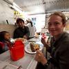 Emilie eating at the market.