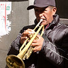 Man playing trumpet for a procession through the streets of La Paz.