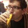 Yann eating a saltena (a juicy Bolivian empanada).