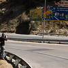 Yann taking pictures on the highway from El Alto to La Paz