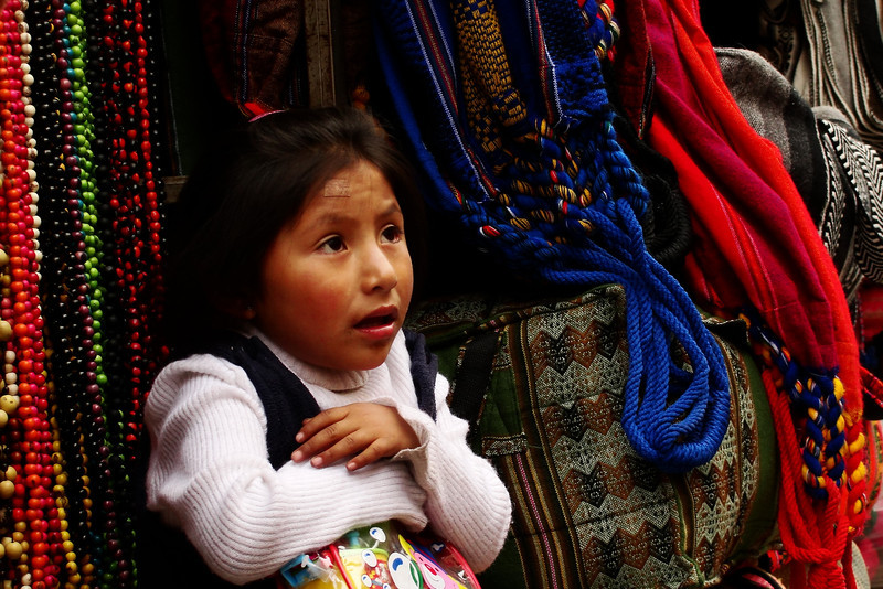 """A cute girl looking up at a local market - La Paz, Bolivia.  A travel photo from the colourful and diverse markets of La Paz, Bolivia. <a href=""""http://nomadicsamuel.com"""">http://nomadicsamuel.com</a>"""