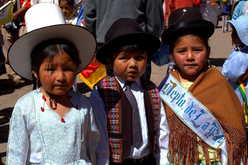 Children representing different regions of Bolivia.