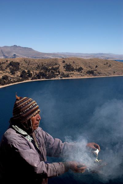 Shaman performing a ritual over Titicaca lake.