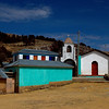 A church sits above the tiny village of Cha'lla
