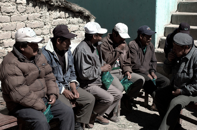Older miners chew on coca leaves before entering the mine.