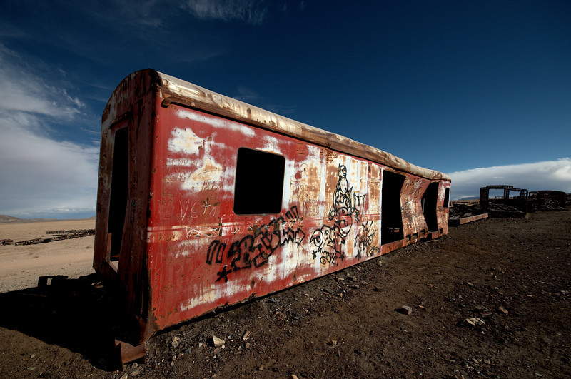 Graffiti covers most of the old train wagons