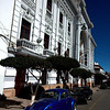 Old car parked in front of Sucre government buildings