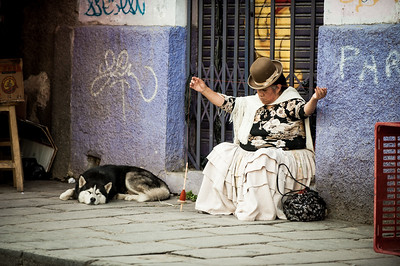 A Bolivian woman spins wool on the street, La Paz, Bolivia, South America