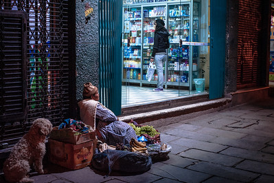 A Bolivian woman sells her fruit outside a pharmacy, La Paz, Bolivia, South America