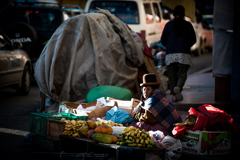 A Bolivian women sells her fruit on a street corner, La Paz, Bolivia, South America