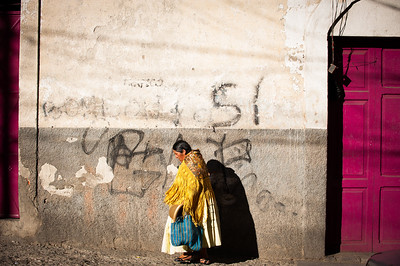 A Bolivian woman walks in the sunshine, La Paz, Bolivia, South America