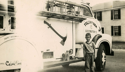 Jack Holbrook standing next to Engine 5, 1949 GMC