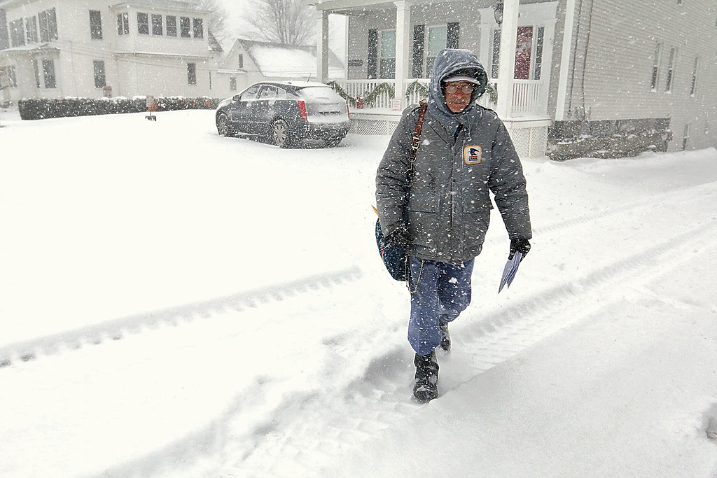 . U.S. Postal Carrier Wade Landgraf was out delivering mail on West Street in Leominster during the storm on Thursday morning. SENTINEL & ENTERPRISE/JOHN LOVE