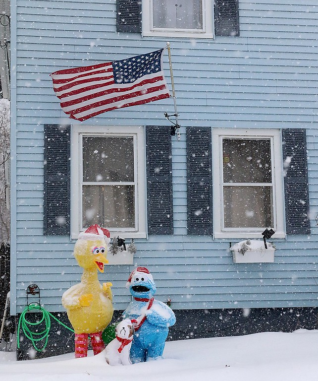 . Big Bird and Cookie Monster where not afraid of the storm on Thursday at this home in Leominster. SENTINEL & ENTERPRISE/JOHN LOVE