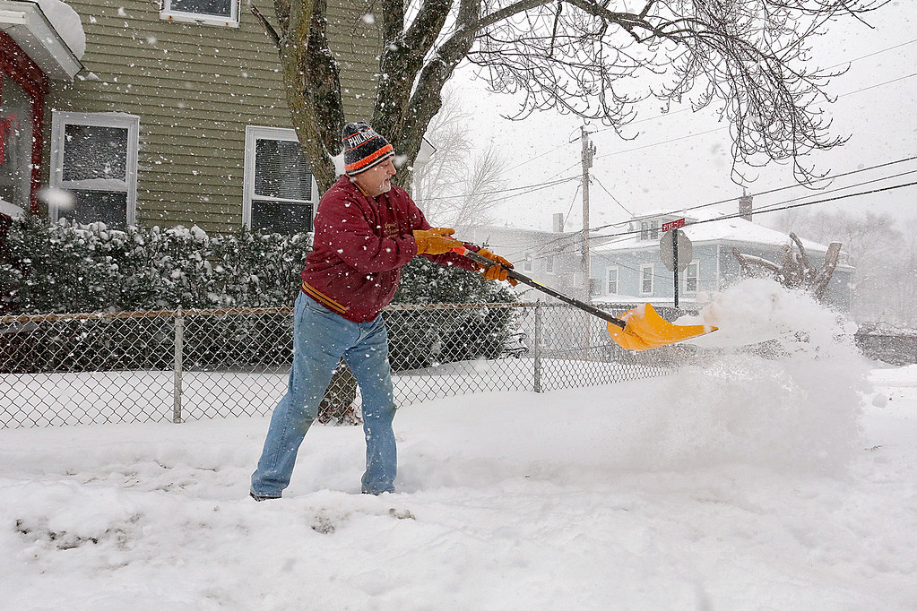 . Anthony Panzarella shovels the sidewalk in front of his house on Rollstone Street in Fitchburg that he has lived in since 1977. SENTINEL & ENTERPRISE/JOHN LOVE