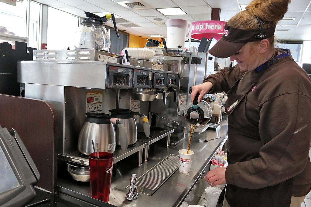 . Dunkin Donuts employee Brenda Percoskie talks about working during Thursday\'s storm. SENTINEL & ENTERPRISE/JOHN LOVE