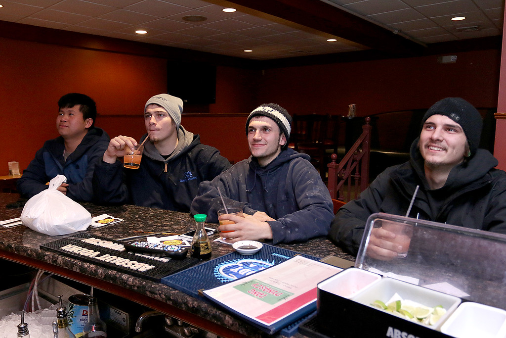 . Hanging out at the Tang Dynasty in Leomister around 2:30 to watch the Celtics game after getting off work is, from left, Chandara Lim, Christopher Ayotte, Dominic Arsenault and Brandon Ayotte. SENTINEL & ENTERPRISE/JOHN LOVE