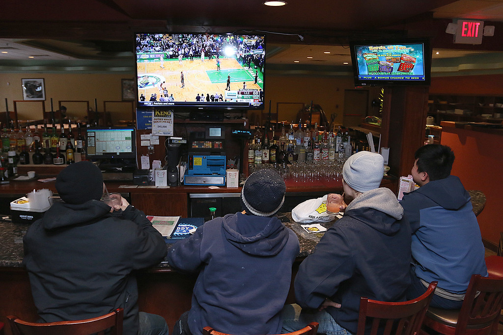. Hanging out at the Tang Dynasty in Leomister around 2:30 to watch the Celtics game after getting off work is, from right, Chandara Lim, Christopher Ayotte, Dominic Arsenault and Brandon Ayotte. SENTINEL & ENTERPRISE/JOHN LOVE