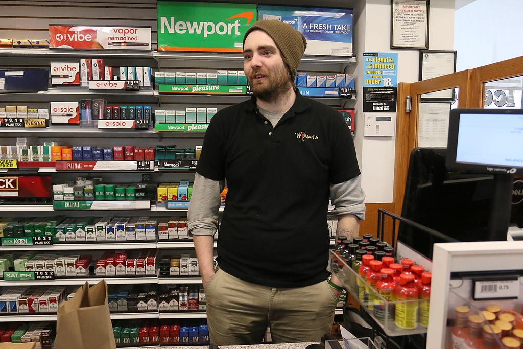 . Wyman\'s Liquors store employee Pierce Salvedla talks about working during storms. SENTINEL & ENTERPRISE/JOHN LOVE