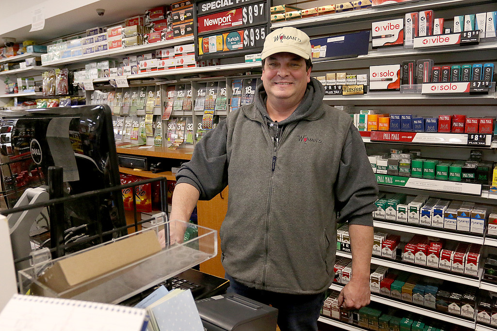 . Wyman\'s Liquors store employee David DeCarolis  talks about how he goes out and drives people to Wyman\'s to work so that they stay safe during storms. SENTINEL & ENTERPRISE/JOHN LOVE