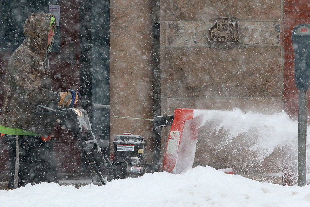 . It was getting hard for everyone to keep up with the storm. This snowplower was doing his best to get the sidewalks cleaned in front of the Phoenix building on Main Street in Fritchburg. SENTINEL & ENTERPRISE/JOHN LOVE