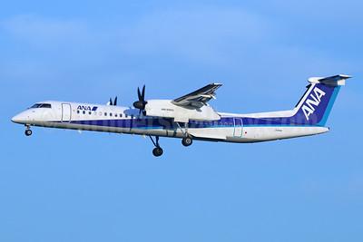 ANA (All Nippon Airways)-ANA Wings Bombardier DHC-8-402 (Q400) JA842A (msn 4082) NRT (Michael B. Ing). Image: 925939.