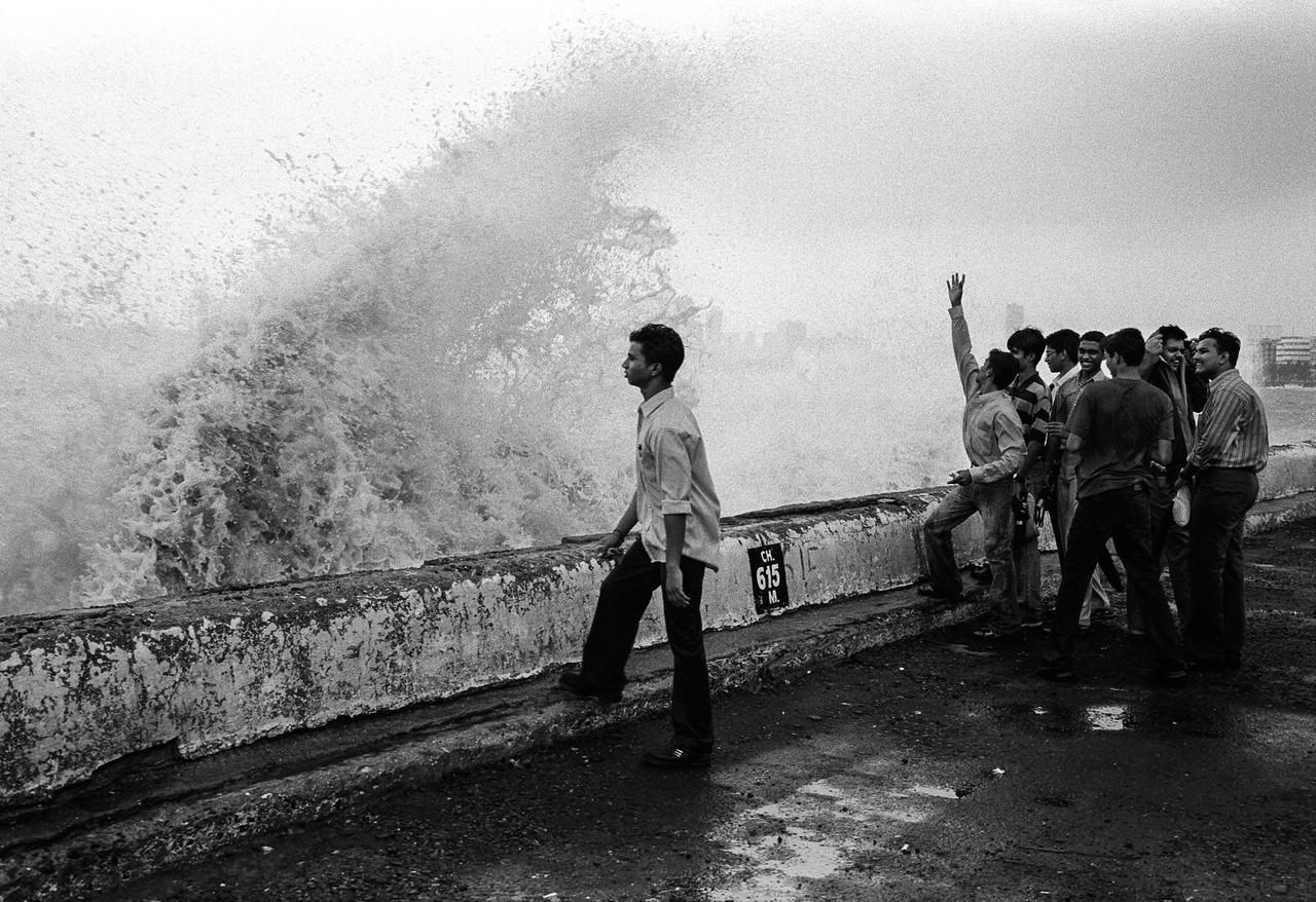 Man on Marine Drive with monsoon waves
