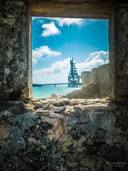 Bonaire's Salt Pier as Seen Through the Ruins of the old Salt Works