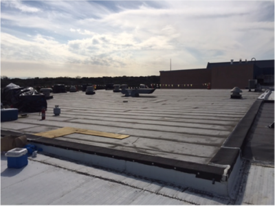 Reroofing high school ongoing in January 2017.