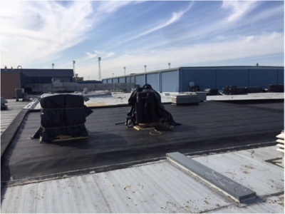 Reroofing the high school in January 2017.