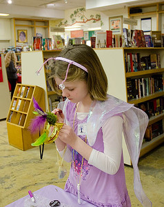 Fairy constructs her mask...  Dragonswood Booklaunch, Author Janet Lee Carey, photo credit - Heidi Pettit