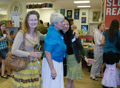 Celebrants are greeted... (Pictured: authors Dia Calhoun, Peggy King Anderson, and Justina Chen)...  (c) photo by Heidi Pettit